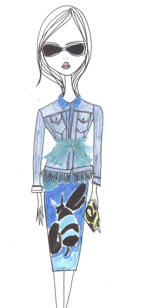 IRMA wears a tulle belt with a fur-trimmed jean jacket by Burberry Prorsum