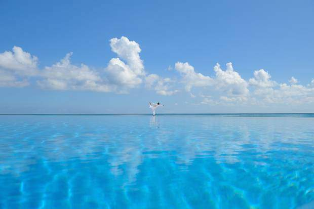 After your Spa treatment, dip into the Spa's Jacuzzi. Practice yoga right on the beach, next to the infinity pool.