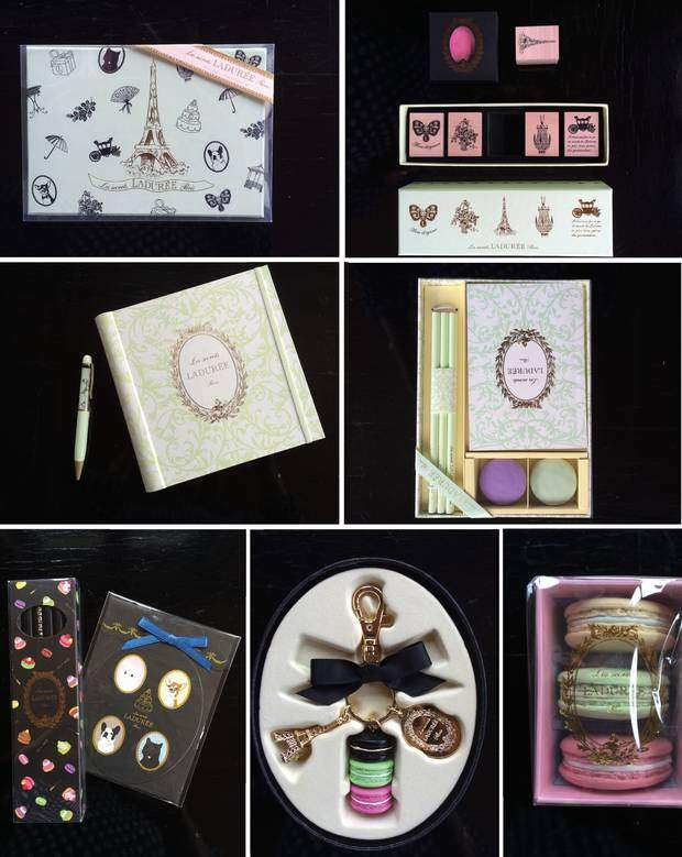 From top left to bottom right: Stationary Paper Box Arabesque, Rubber Stamp Set Arabesque and Ink Pad Rose, Rubber Stamp Set Arabesque and Ink Pad Rose & Guest/Photo Book Ladurée and ballpoint-pen Arabesque, Stationary Set Arabesque with Pencils, Notebook and Macaron Rubbers, Pencil Set & and Gift Tag Gourmandise, Black Key Ring Réglisse, Macaron Erasers Rose, limited edition only