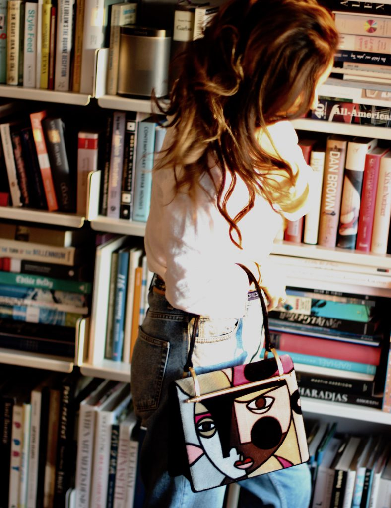 300da6662d17 JK from IRMASWORLD in front of her bookcase, print bag by Prada